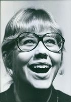 Portrait photo of a woman while smiling.