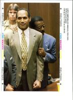 Defendant O.J Simpson gets a hug from lead defense.