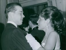 Prince Michel and Béatrice Marie Pasquier dancing on a party.