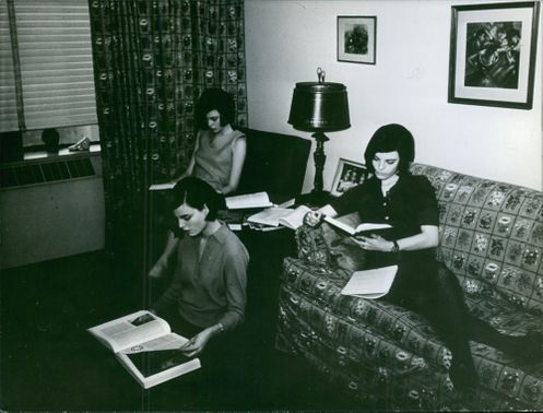 The Dee triplets reading a book. 1964.