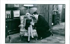 """Meg Ryan and Stephen Fry in the film """"I.Q"""", 1994."""