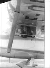 Marina Vlady sitting in plane with a man.