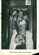 Actress Grace Moore descends from the train with her husband Valentín Parera