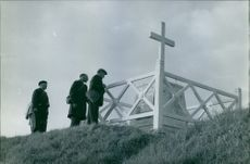 Gentlemen are facing the crucifix on the hill top. 1966