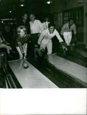 Sacha Diste and Anette Stroyberg playing bowling.