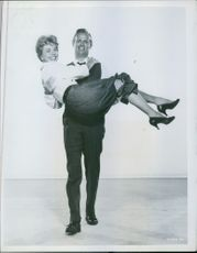 Richard Widmark carries Doris Day in The Tunnel of Love. 1959.