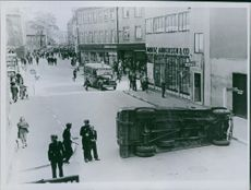 A car flip side on the street during the German occupation of Denmark, 1944.