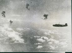 U.S. Bomber over target in Libya This American B-24 bomber, surrounded by bursting anti-aircraft shells starting its run over its target, Axis shipping at Benghazi, Libya during the Allied offensive in North Africa.