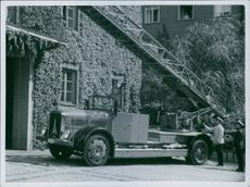 A fire brigade's truck with a turntable ladder.