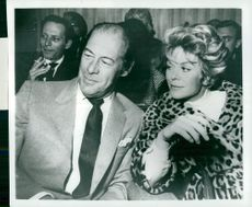 "Rex Harrison along with his wife Rachel Roberts at the premiere of ""America America"""