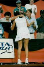 Monica Seles hugs about his father after the profit in Toronto