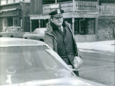 Police at his car in Lake Placid, USA, 1980.