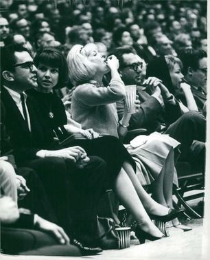 Doris Day sitting in hall.