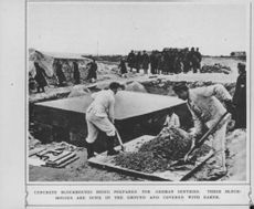 Concrete Blockhouses being prepared for German sentries. These blockhouses are sunk in the ground and covered with earth.