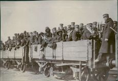 Soldiers travelling in a train and looking towards the camera. 1904