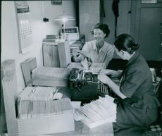 Bismarck, Otto- fruste 1953  Ann-Marie checking office files with her secretary working on a typewriter.