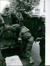 Vintage photo of soldiers in Bizerte helping out a wounded comrade getting on the truck. Photo taken on July 26, 1961.