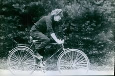 Russian cosmonaut and politician Valentina Tereshkova is riding a bicycle