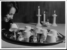 Here Hiram laid a tray with turned over cups on to use in the New Years foretelling game.