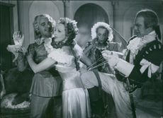 A scene from the film Kungajakt with Stig Järrel, Inga Tidblad and Björn Berglund, 1944.