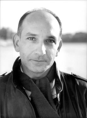 A black and white portrait photograph of British-Indian actor Ben Kingsley.