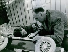 Pierre Marcilhacy playing with a boy.