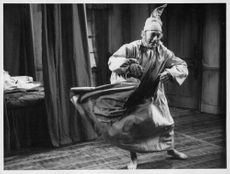 A man dancing in a movie scene.