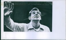 Portrait of an American composer, conductor, author, music lecturer, and pianist Leonard Bernstein waving. 1960