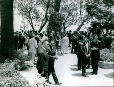 Algerian agents gathered in a party conducted by Houari Boumediene. Photo taken on July 21, 1965.