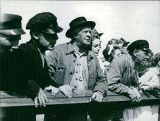 A photo from the movie Sangen om den eldroda blomman , Swedish drama film from 1956 , directed by Gustaf Molander