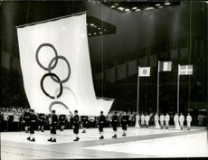 The Olympic flag is lifted at the closing ceremony during the 1968 Olympic Winter Games