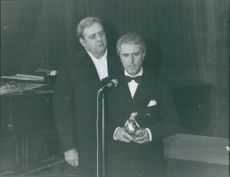 Raymond Burr standing together with a man holding a trophy, 1972.