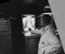 Doctor checking x-ray.