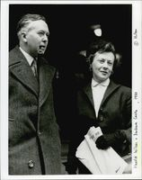 Harold Wilson standing with Barbra Castle in the event.