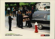The coffin arrives at the church at Vitas Gerulait's burial on Long Island