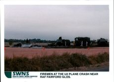 Aircraft crash:firemen at the u2 spy plane.