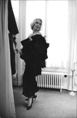 Carroll Baker standing and looking back.