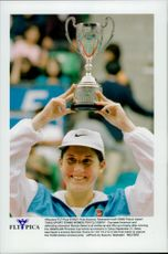 Monica Seles holds up his trophy after winning the Princess Cup in Tokyo