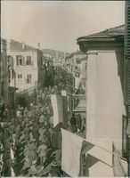 Aerial view of soldiers marching in the street during World War I, 1916.
