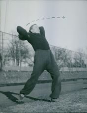 Man holding a football and forcing to throw it, during the training.