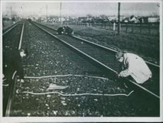 War Damages in Denmark during German occupation. People measuring the damages railway track.