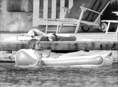 SEX - Brigitte Bardot sunbathing topless on holiday