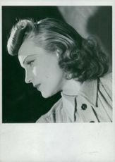 Woman in a coiffure hair style from 1940.