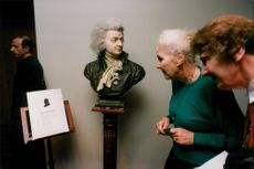 Older ladies are watching the thing during a Mozart memorial show