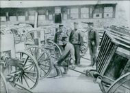 Russo-Japanese War 1904-1905 Japanese soldiers asking the other soldier to mend the cart wheel.