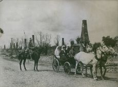 Soldiers riding their horses in the filed in Poland during WWI, 1915.