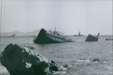 A ship sinking into the sea during the war, 1970.