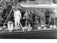 Prince of Whales in a yacht with his companion. 1962