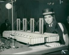 Miss Lydia Parry with a model of the British Pavilion.