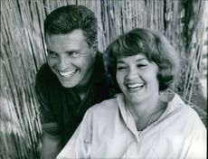 Liselotte Pulver laughing with Helmut Schmid.